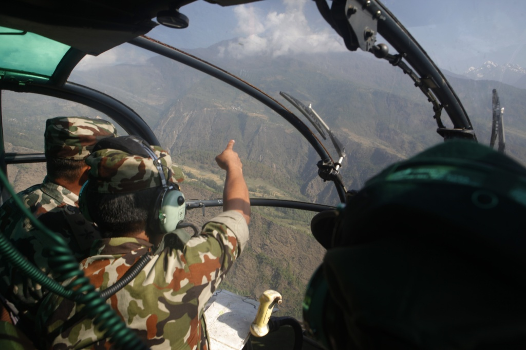 Nepalese army men search for the missing U.S. Marine helicopter in the earthquake affected Dolakha District, Nepal, Thursday, May 14, 2015. The helicopter carrying six Marines and two Nepalese soldiers disappeared Tuesday while delivering aid in the country's northeast and later