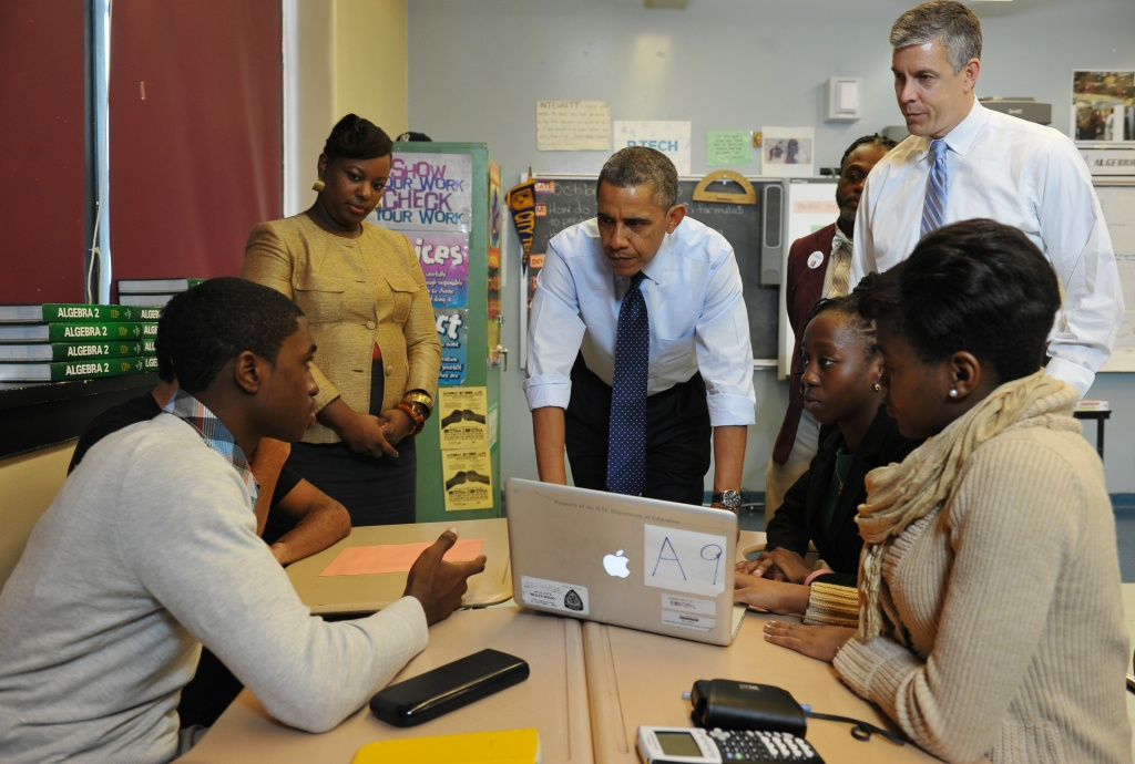 US President Barack Obama chats with students during a visit to a classroom at Pathways in Technology Early College High School, in Brooklyn, New York on October 25, 2013.