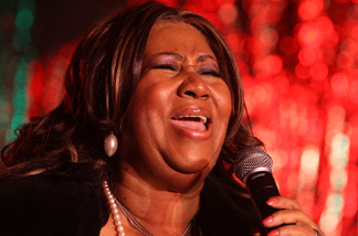 Singer Aretha Franklin performs at the 85th annual New York Stock Exchange Christmas tree lighting festivities on Wall Street December 4, 2008 in New York City.