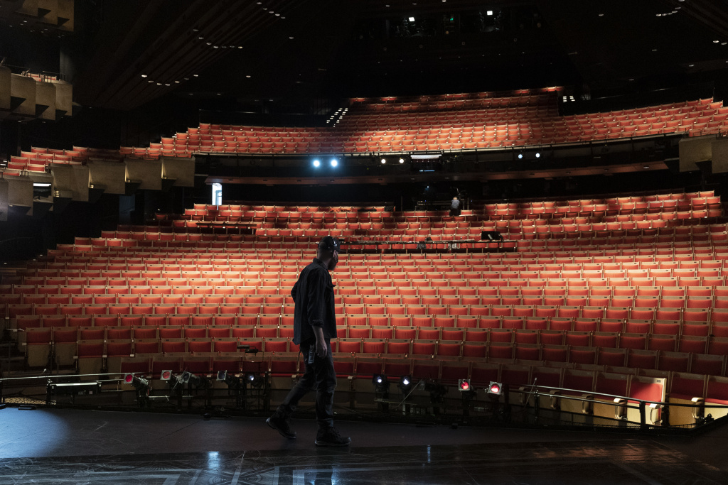 A stage hand prepares for dress rehearsals for Opera Australia's production of