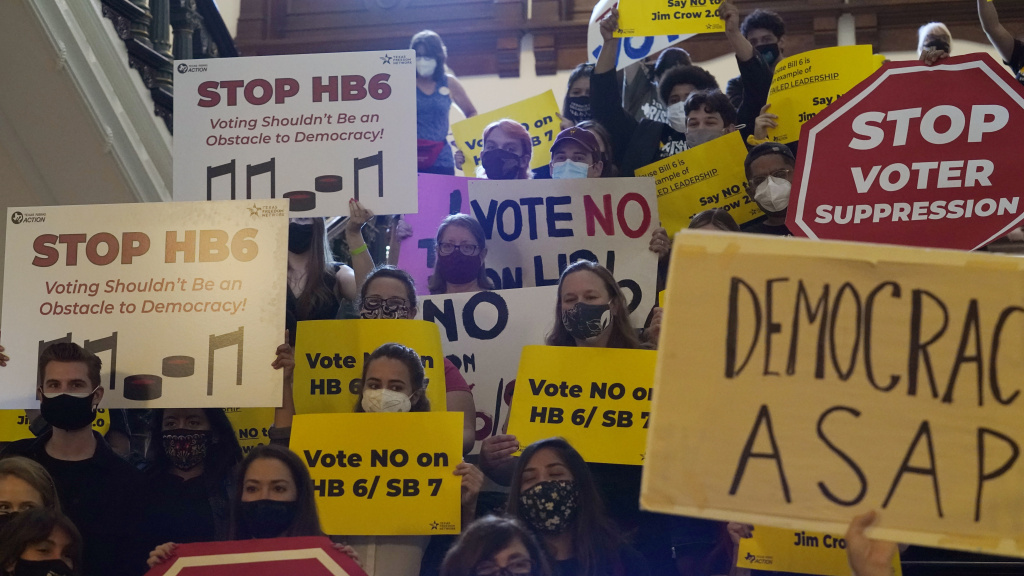 In this May 6, 2021 file photo, a group opposing new voter legislation gather outside the House Chamber at the Texas Capitol in Austin. Texas Republicans dug in Saturday, for a final weekend vote on some of the most restrictive new voting laws in the U.S., finalizing a sweeping bill.