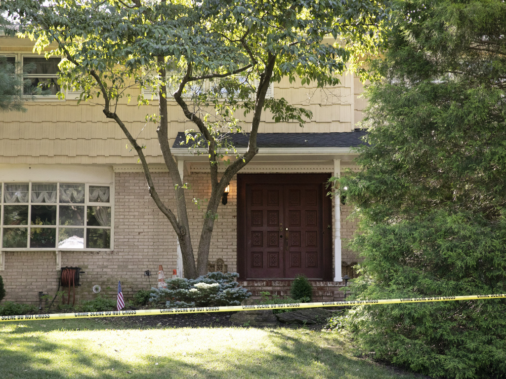 Crime-scene tape surrounds the home of federal Judge Esther Salas in North Brunswick, N.J., on July 20. A gunman shot and killed Salas' 20-year-old son and wounded her husband.