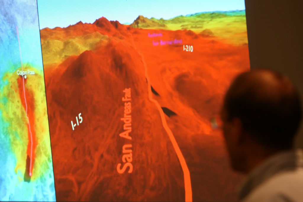 Research Geophysicist with the United States Geological Survey (USGS), Brad Aagaard, shows members of the media a series of images that illustrate how shock waves from an expected catastrophic 7.8 magnitude earthquake on the San Andreas Fault would likely fan out across southern California.
