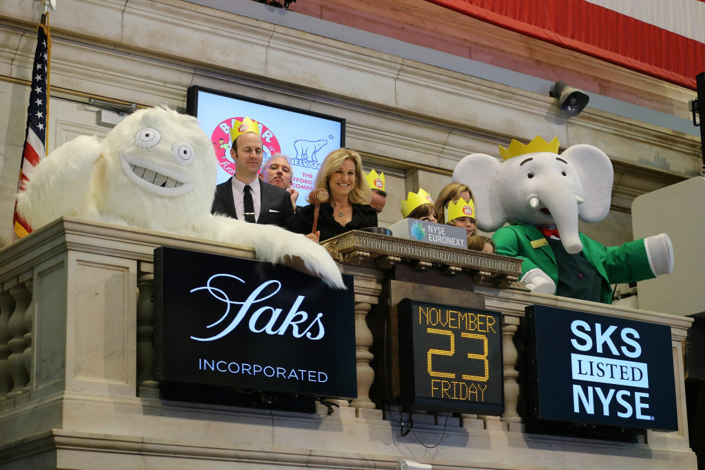 Babar the Elephant, the French fictional children's character, with the Saks Yeti, Tracy Haffner, and Colin Bohm who rang the closing bell at the New York Stock Exchange on November 23, 2012 in New York City.