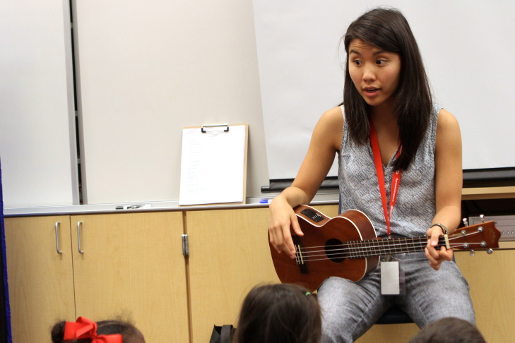 Zoe Kumagai, 23, a new music teacher at Veterans Elementary School in Chula Vista, California, instructs a group of kindergarten students. Kumagai is one of more than 10 first-year teachers hired by the Chula Vista Elementary School District. Due in part to the teacher shortage in California, the district is still trying to hire 16 additional art teachers.
