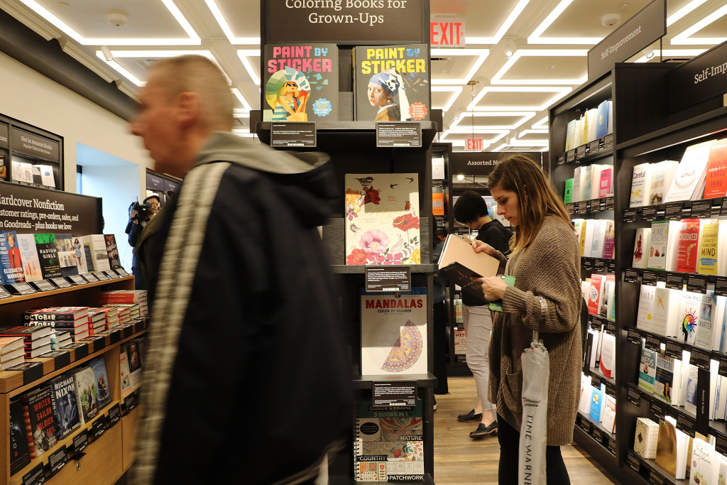 People shop in the newly opened Amazon Books on May 25, 2017 in New York City.