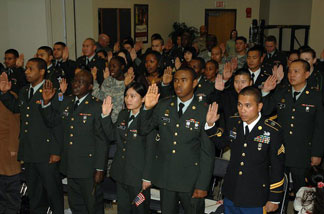 A military naturalization ceremony held at a U.S. Army base in South Korea, December 2008. A new Obama administration policy aims to make it easier for immediate relatives of U.S. military who are immigrants to obtain legal status, but not everyone likes it.