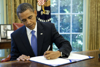 U.S. President Barack Obama signs an extension of unemployment benefits at the White House on July 22, 2010 in Washington, D.C. Earlier today the President signed the Improper Payments Elimination and Recovery Act that will require federal agencies to put forth more funds towards audits to curb improper spending.