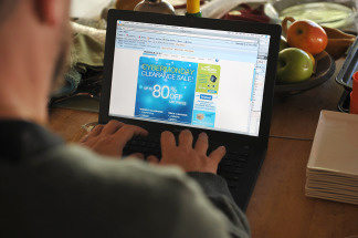 A man looks at an advertisement on his laptop computer in Los Angeles on November 30, 2009.