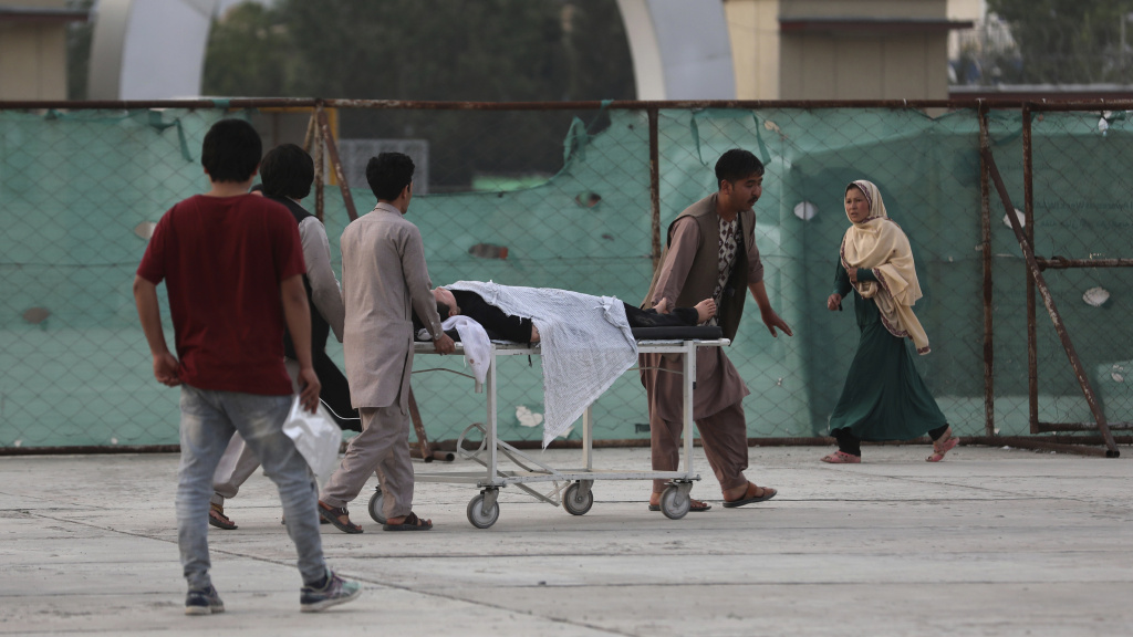 An injured school student is transported to a hospital after a bomb explosion near a school in Kabul, Afghanistan, Saturday.