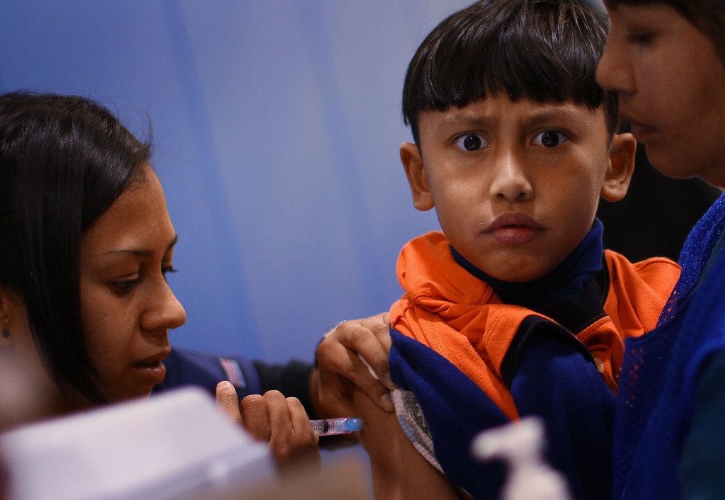 In this file photo, a student receives a vaccination at Carlin Springs Elementary School January 7, 2010 in Arlington, Virginia. California public health officials say the anti-vaccination movement could spark a resurgence of measles, since the unvaccinated are more susceptible to contracting it.