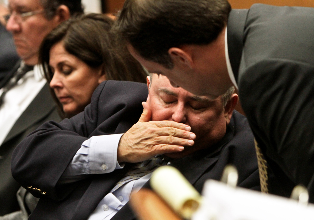 Attorney James Spertus, right, talks to his client former Bell City Administrator Robert Rizzo as the court waits for a witness during a preliminary hearing at Los Angeles Superior Court Feb. 22, 2011 in Los Angeles, California.