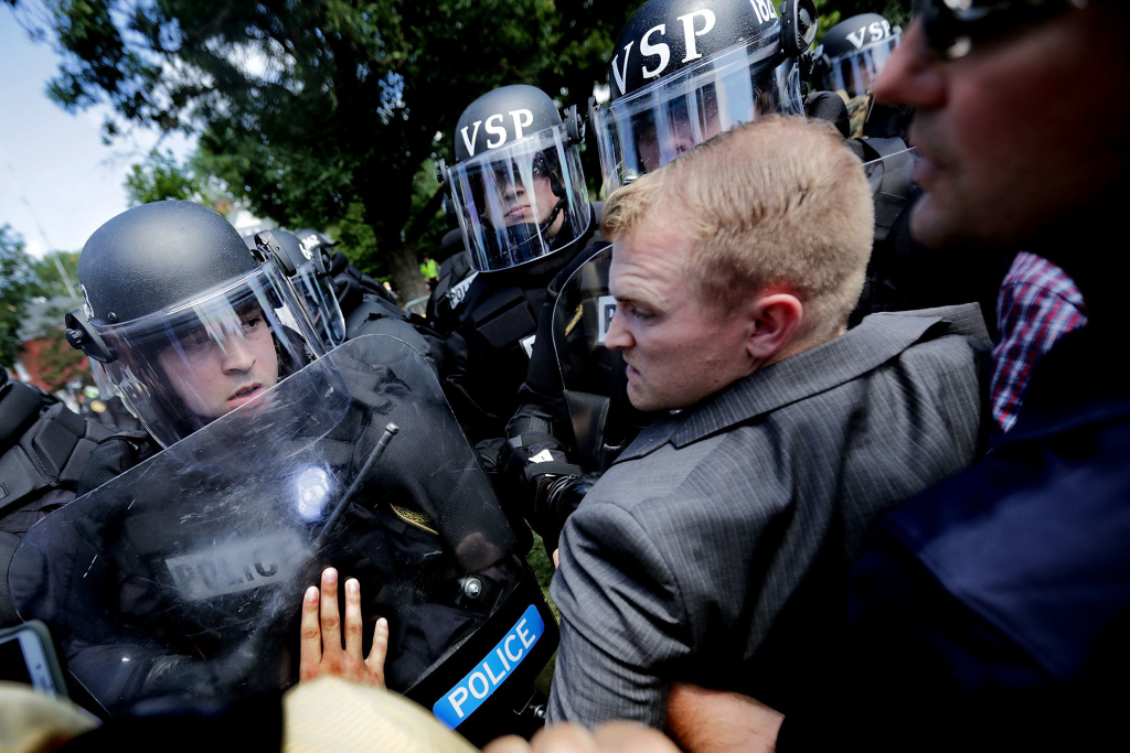 White nationalists clash with police as they are forced out of Emancipation Park after the