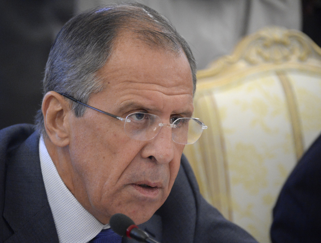 Russia's Foreign Minister Sergei Lavrov (R) speaks with his French counterpart Laurent Fabius during their meeting in Moscow, on September 17, 2013. Lavrov said Wednesday that Russia intends to show evidence to the U.N. Security Council that rebels carried out a chemical weapons attack on Aug. 21.