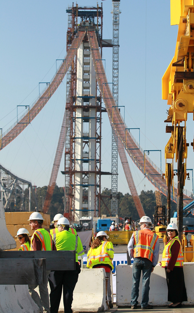 Engineers say the new span of the San Francisco-Oakland Bay Bridge would be able to handle a large earthquake much better than its aging counterpart. (Photo: Oakland mayor Jean Quan (R) tours a construction site at the final deck section of new self-anchored suspension span of the Bay Bridge on October 28, 2011 in Oakland, California. By Justin Sullivan/Getty Images)