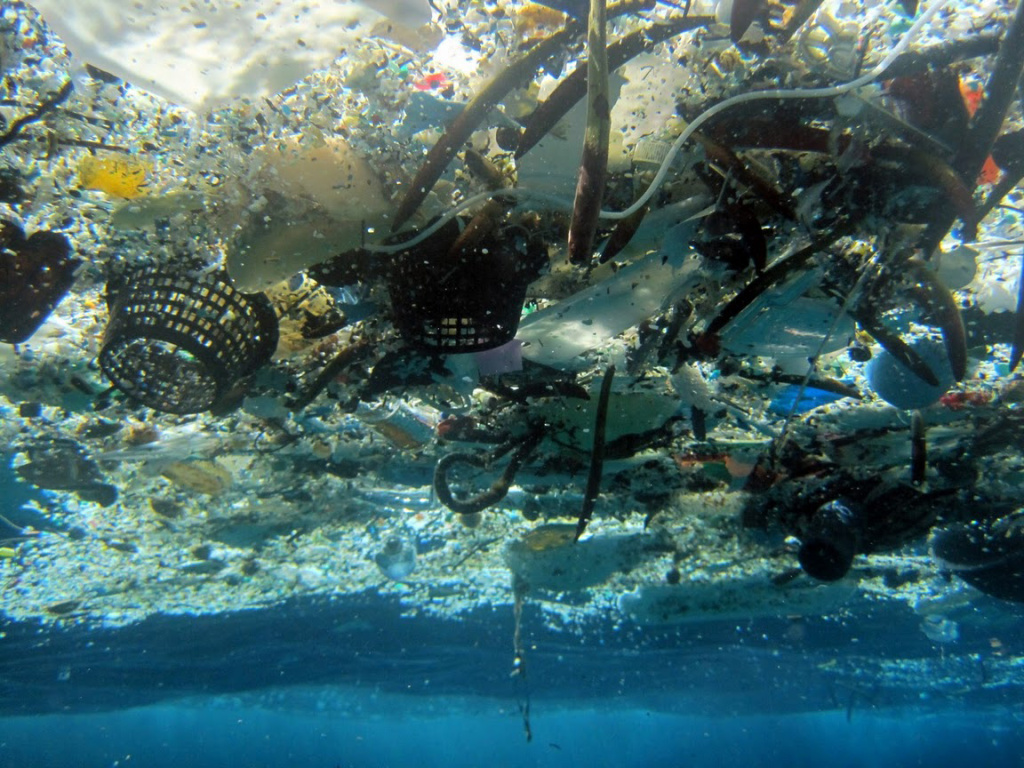File: This file 2008 photo provided by NOAA Pacific Islands Fisheries Science Center shows debris in Hanauma Bay, Hawaii. A new study estimates nearly 270,000 tons of plastic is floating in the world's oceans. That's enough to fill more than 38,500 garbage trucks if each truck carries 7 tons of plastic. The figure appears in a study published, Wednesday, Dec. 10, 2014, in the scientific journal PLOS ONE. Researchers say the plastic is broken up into more than 5 trillion pieces.