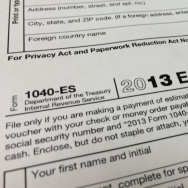 Proposals that would simplify the filing process for many Americans are under fire from tax-preparation company TurboTax. Here, a 2013 IRS Estimated Tax form.