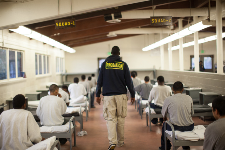 A probation officer walks through a dormitory at Camp Afflerbaugh.
