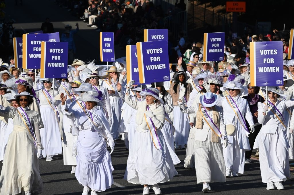 Women dressed as suffragettes celebrating the 100th anniversary of the 19th amendment of the US Constitution granting women the right to vote participate in the 131st Rose Parade in Pasadena, California, January 1, 2020.