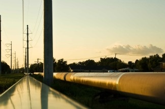 A pipeline brings oil to a refinery.