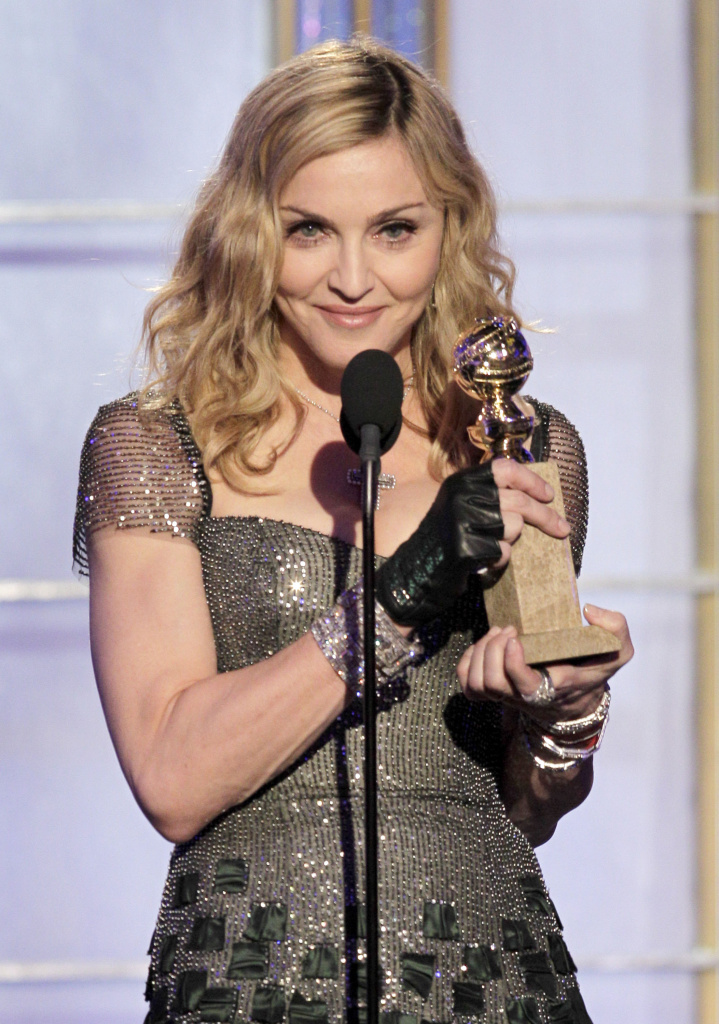 "Madonna accepts award for Best Original Song - Motion Picture "" Masterpiece"" during the 69th Annual Golden Globe Awards"