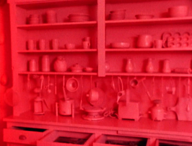 "Robin Weltch painted every inch of the Womanhouse kitchen a Pepto Bismol pink for her piece, ""Nurturant Kitchen."""