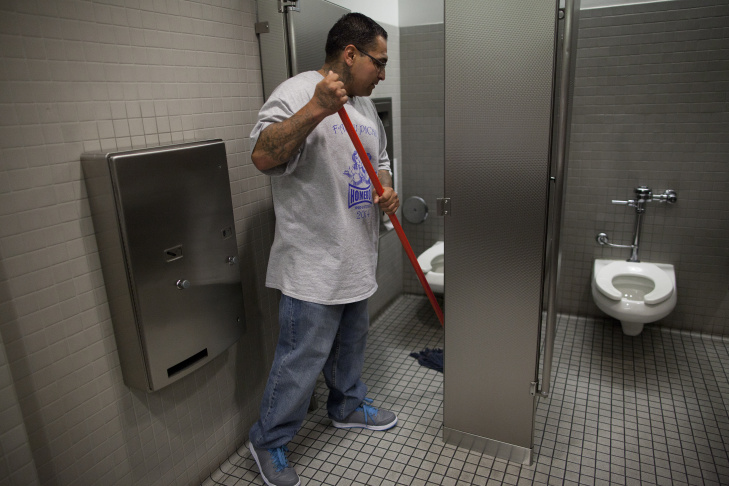 Gabriel Lopez, left, takes a cigarette break while working at Homeboy Industries. He works a variety of jobs there, all part of a program to reintegrate people with criminal histories into the workforce.