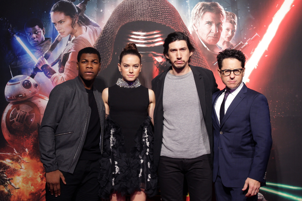 (L to R) Actor John Boyega, actress Daisy Ridley, actor Adam Driver and director J.J. Abrams attend  the event for fans ahead of 'Star Wars: The Force Awakens.'