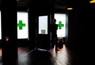 A client enters Sunset Junction medical marijuana dispensary in Los Angeles, California.