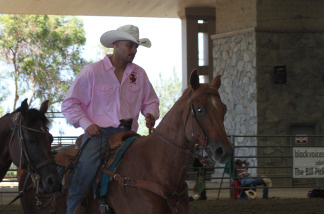 Reuben Haynes, 35, a resident of Los Angeles rides in the main arena just before he competes in the bull doggin' event.