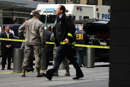 Police, FBI and other emergency workers gather outside the Time Warner Center after an explosive device was found this morning on October 24, 2018 in New York City.