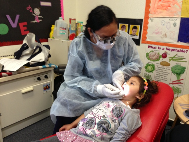 Mireya Rodriguez, a dental hygienist, administers temporary fillings to four-year-old Erika Ruiz at a pre-school in Culver City. Hygienists aren't usually allowed to give temporary fillings, but Rodriguez is part of a pilot project testing whether hygienists might become the new front line for care for low-income children.