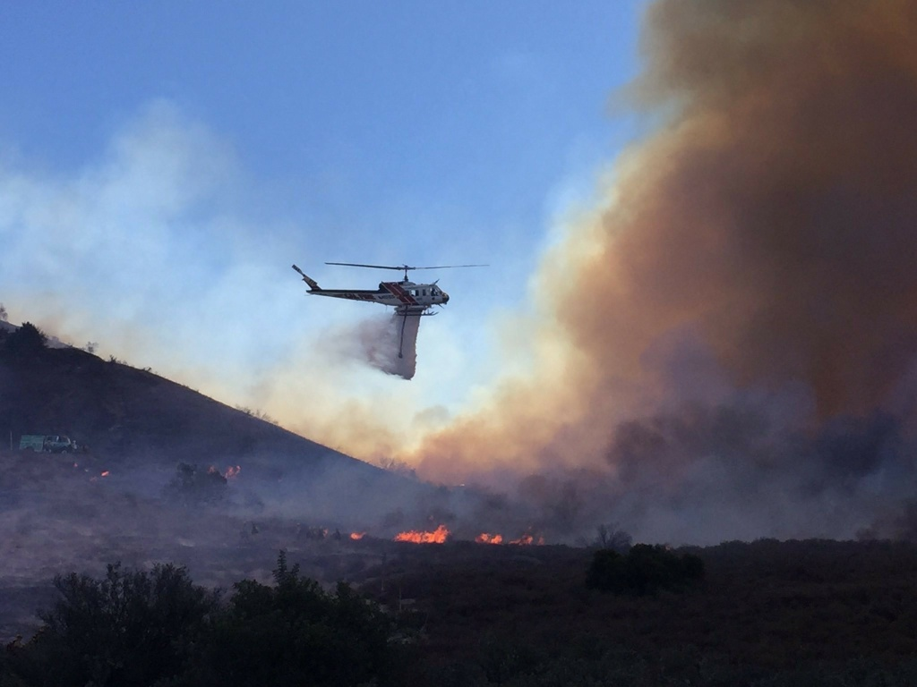 A helicopter drops waters on the Canyon Fire, which has scorched nearly 3,000 acres in September.