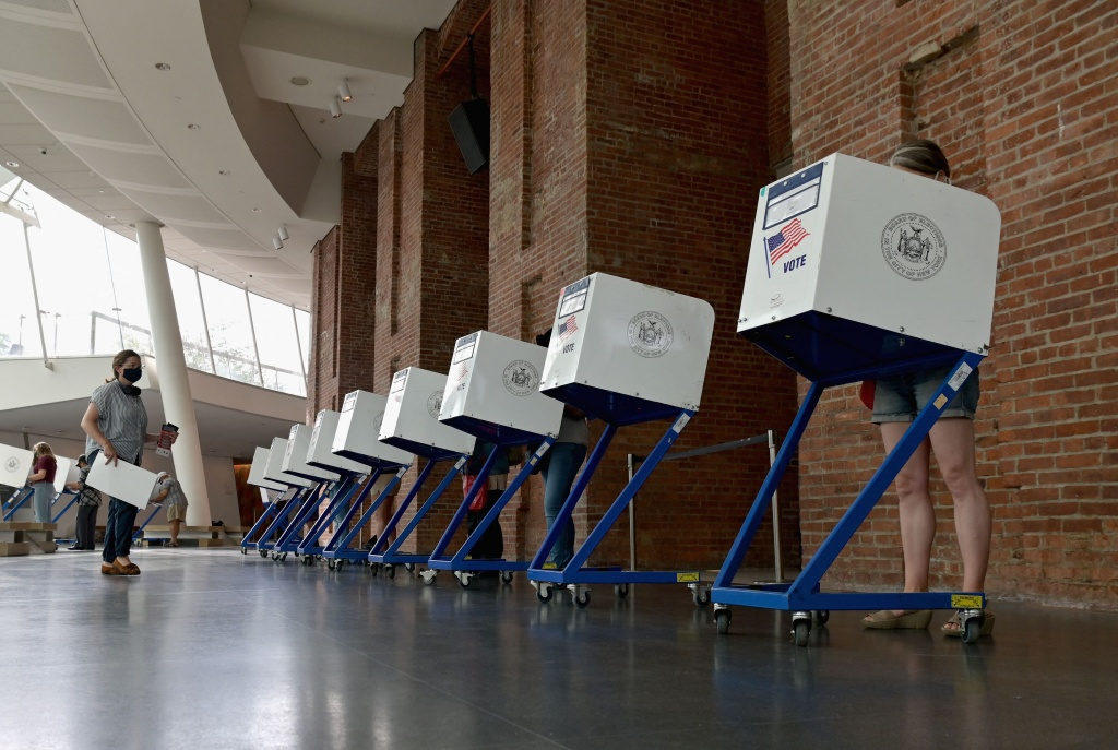 Residents vote during the New York City mayoral primary election at the Brooklyn Museum polling station on June 22, 2021 in New York City.