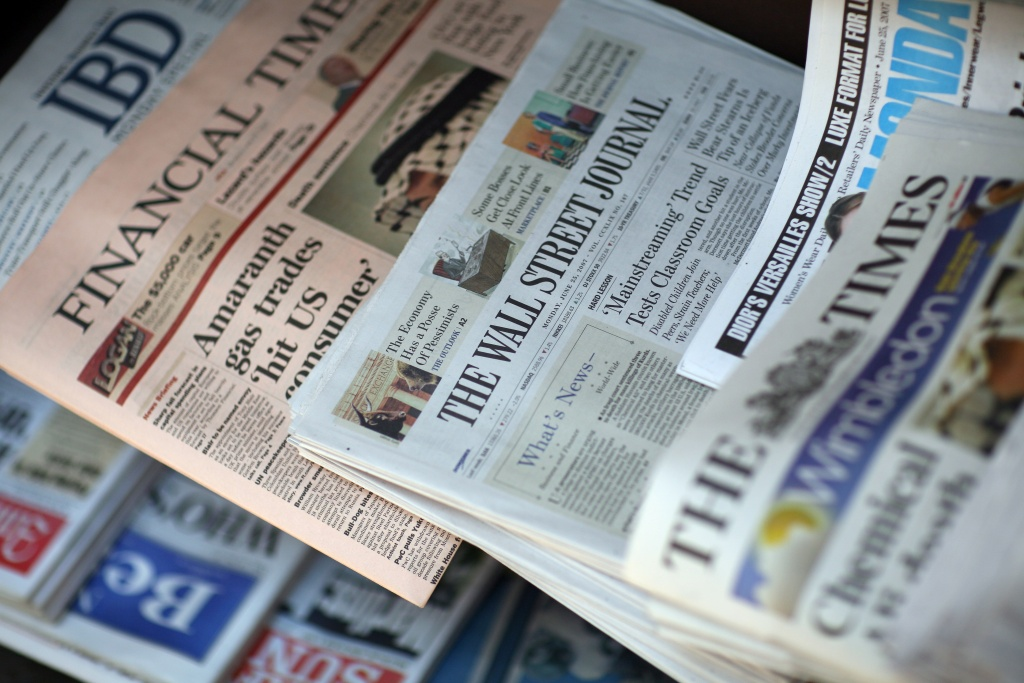 Copies of the Wall Street Journal and other newspapers sit on display at a newsstand on Exchange Place on June 25, 2007 in New York City.