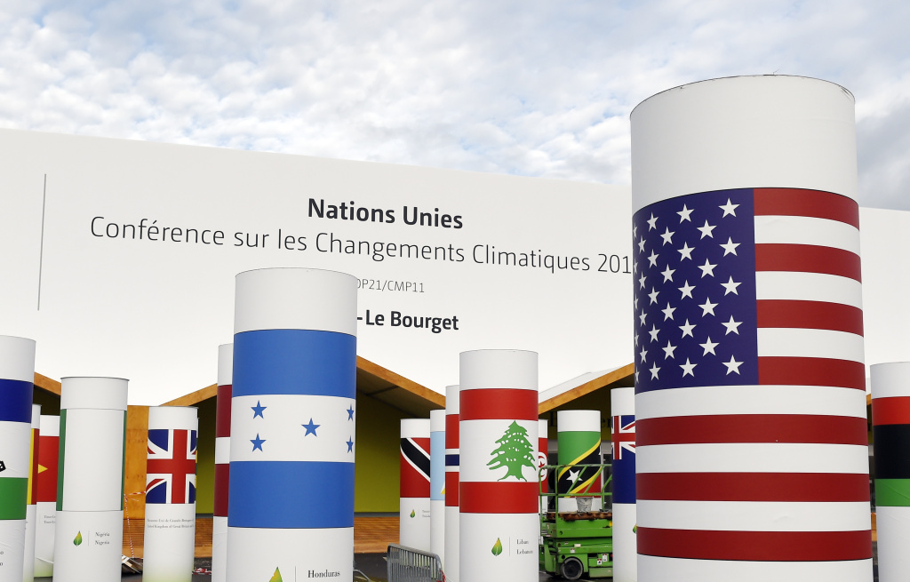 Pillars with the names and national flags of countries attending the COP 21, UN climate conference, decorate the outside of the venue hall,  on November 25, 2015, in Le Bourget, north of Paris.