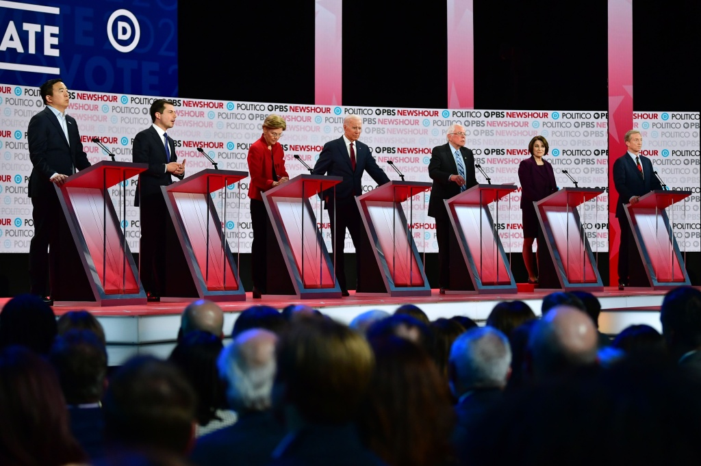 (From L) Democratic presidential hopefuls, entrepreneur Andrew Yang, Mayor of South Bend, Indiana Pete Buttigieg, Massachusetts Senator Elizabeth Warren, former Vice President Joe Biden, Vermont Senator Bernie Sanders, Minnesota Senator Amy Klobuchar and businessman Tom Steyer participate of the sixth Democratic primary debate of the 2020 presidential campaign season at Loyola Marymount University in Los Angeles, California on December 19, 2019.