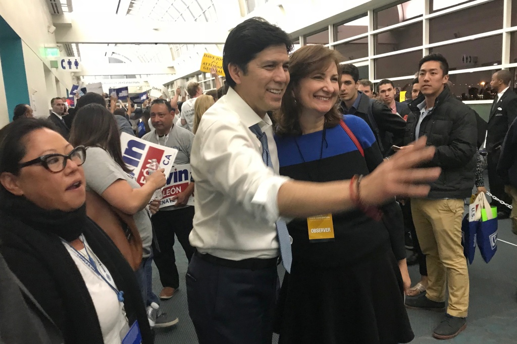 State Senate leader Kevin de Leõn poses with supporters moments after delegates finished voting for their endorsement picks at the California Democrats' state convention in San Diego.