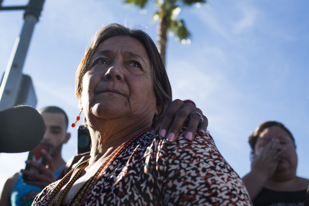 Olivia Navarro, 63, speaks to media about her daughter, Jamil Navarro, who works in the Inland Regional Center in San Bernardino where a mass shooting took place on Wednesday, Dec. 2, 2015.
