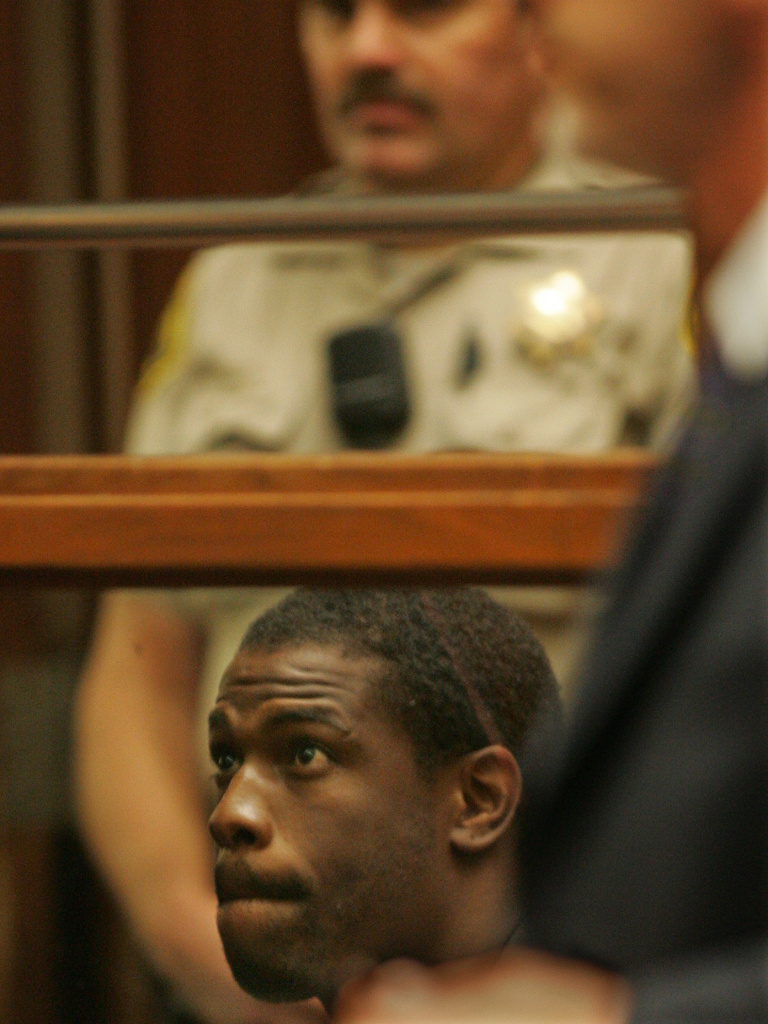 Lawrence Phillips, seen here in a 2005 photo, has been charged with murder while serving a prison sentence for assault and other charges.