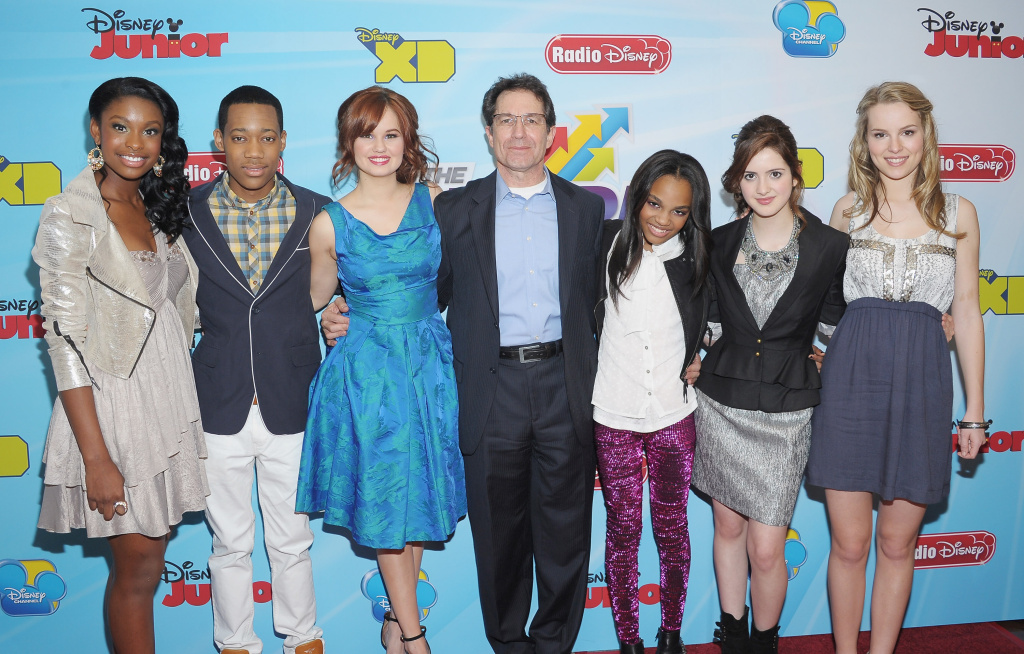 (L-R) Actors Coco Jones, Tyler James Williams, Debby Ryan, Disney Channels Worldwide President and CCO Gary Marsh and actors China Anne McClain, Laura Marano and Bridgit Mendler attend the 2012-13 Disney Channel Worldwide Kids Upfront at the Hard Rock Cafe - Times Square on March 13, 2012 in New York City.