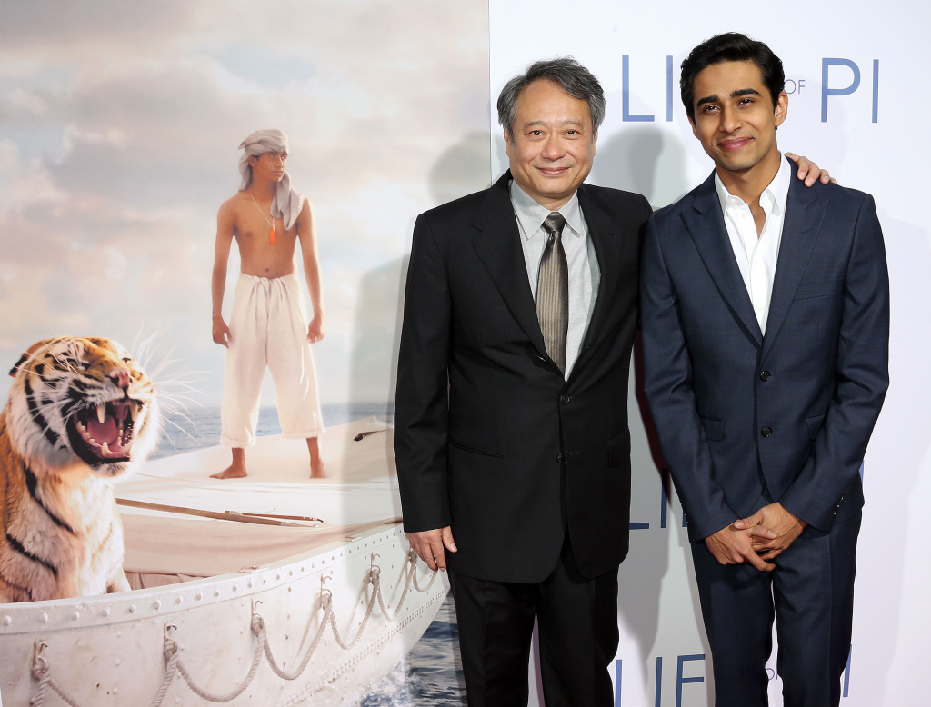 "LOS ANGELES, CA - NOVEMBER 16:  Director Ang Lee (L) and actor Suraj Sharma attend the Special Screening for 20th Century Fox and Fox 2000's ""Life Of Pi"" at the Zanuck Theater, 20th Century Fox Lot on November 16, 2012 in Los Angeles, California.  (Photo by Frederick M. Brown/Getty Images)"