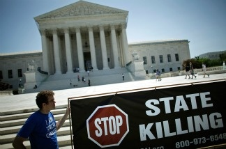 Anti-death penalty advocates stand in front of the U.S. Supreme Court.