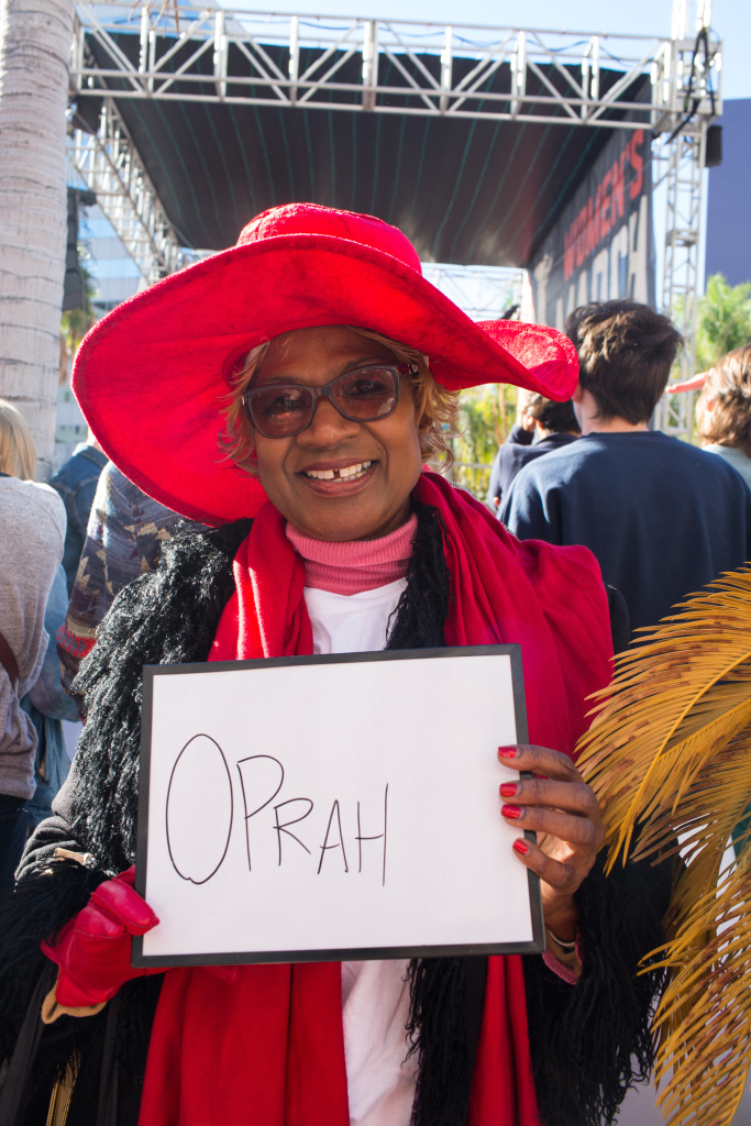 Elizabeth White, 69, of Inglewood. I chose Oprah as my Shero because she's so powerful and has done so much. Let's hope she runs for president. January 20, 2018 at Downtown Los Angeles, California. (James Bernal for KPCC)