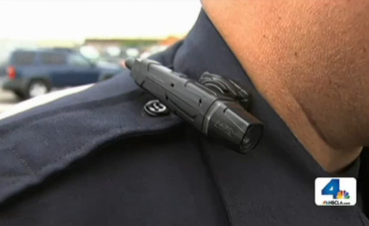 Officer Guillermo Espinoza pushes a button to turn his lapel camera on and off. The cameras don't roll for the entire shift, only when an officer presses record.