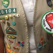 Senior Girl Scout Yasmine Corel holds up her Video Game Designer patch.