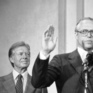 With President Jimmy Carter watching, Benjamin Civiletti is sworn in by Chief Justice Warren Burger as U.S. attorney general on Aug. 16, 1979. The following year, Civiletti issued a legal opinion saying that federal work cannot go on until Congress agrees