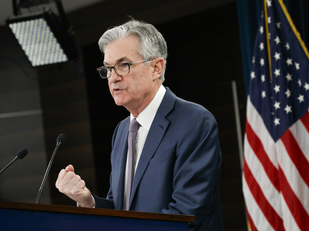 Federal Reserve Chair Jerome Powell speaks during a news conference in Washington on March 3. Companies can borrow money from the Fed under its new lending programs, but the central bank's effort to help the economy has had lopsided results.