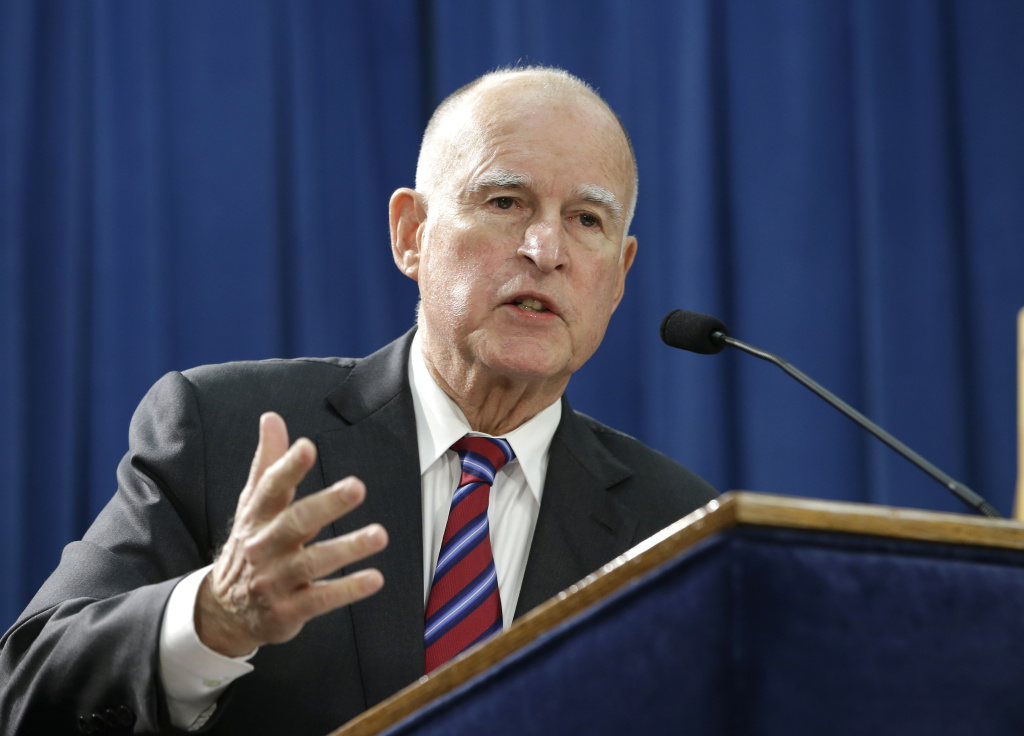 FILE - In this Jan. 7, 2016 file photo, Gov. Jerry Brown answers a question concerning his proposed 2016-17 state budget at a news conference, in Sacramento, Calif. California's Supreme Court is set to hear arguments over Brown's efforts to put his plan to reduce the state's prison population before voters in November. Oral arguments are scheduled for Thursday morning, May 5, 2016, though the justices will not issue a ruling at the hearing.  (AP Photo/Rich Pedroncelli, File)