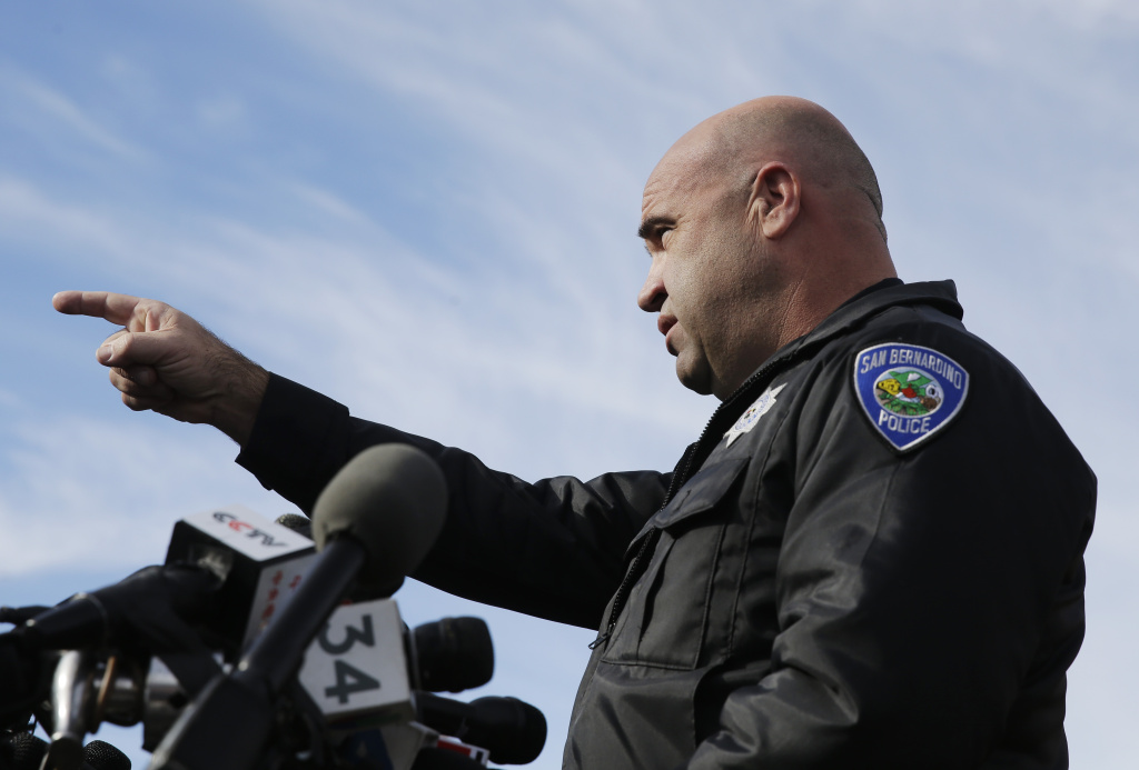 San Bernardino Police Chief Jarrod Burguan, takes a question during a press conference near the site of yesterday's mass shooting on Thursday, Dec. 3, 2015 in San Bernardino, Calif. A heavily armed husband and wife dressed for battle opened fire on a holiday banquet for his co-workers Wednesday, killing multiple people and seriously wounding others in a precision assault, authorities said. Hours later, they died in a shootout with police. (AP Photo/Chris Carlson)